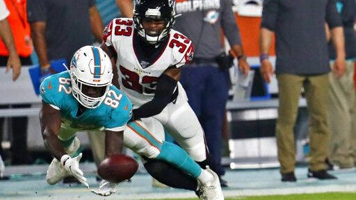 Dolphins rookie receiver Preston Williams (82) makes a catch in front of Atlanta Falcons cornerback Blidi Wreh-Wilson (33) in the first half.