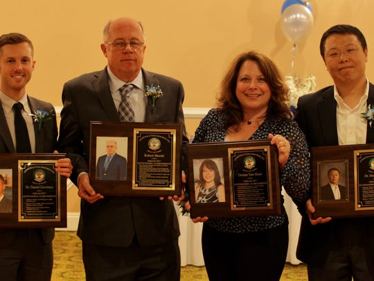 The 2017 inductees into the Sayreville War Memorial High School Hall of Fame. From left on April 29: Dr. Daniel Giovenco, Class of 2006; Robert Merski, Class of 1967; Dorian Van Horn, Class of 1982; and Dr. Stephen Sun, Class of 1988.