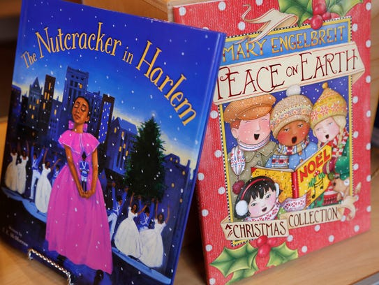 A variety of children's Christmas books, including
