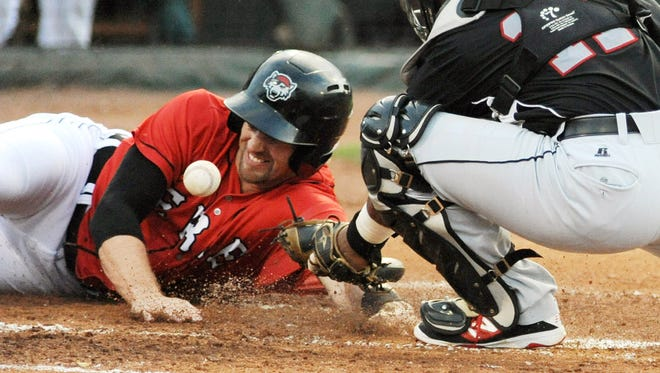 Erie SeaWolves' Connor Harrell slides into home plate as New Britain Rock Cats catcher Jan Vazquez drops the throw during the second inning of a baseball game, Wednesday, Aug. 19, 2015, in Erie, Pa.