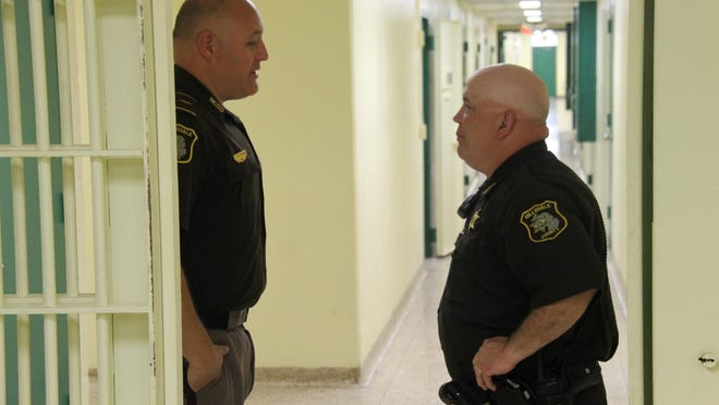 Lt. Jason Stiverson, the jail administrator, speaks with Corrections Deputy Jeff Miller at the jail in 2017.