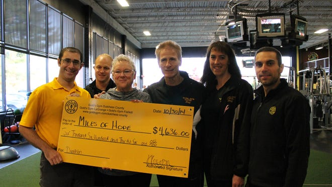 Justin Feldman, left to right, Feldman Physical Therapy; Joe Detz, LaGrange manager; Dana Effron; Ron Paglia; trainer and Duathlon chairman; Krista Brennan, LaGrange assistant manager; and Philip Martinetti, LaGrange fitness consultant, recently gathered for the donation to the Miles of Hope Breast Cancer Foundation.