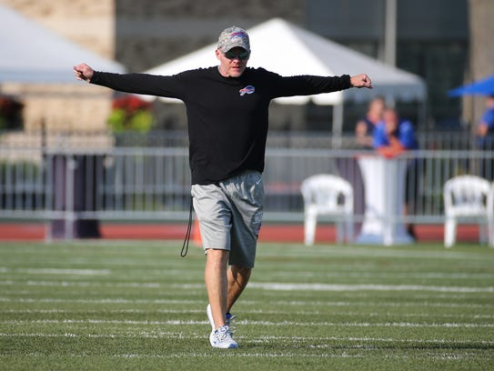 Bills head coach Sean McDermott stretches before a
