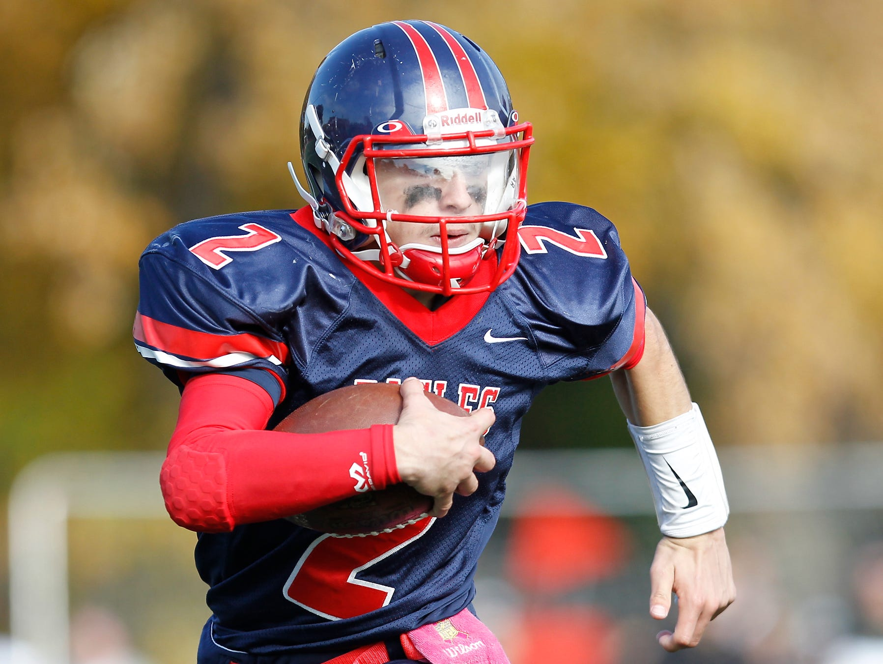 Eastchester quarterback John Arcidiacono (2) runs around the outside during their 19-27 loss to Our Lady of Lourdes High School in the class A semi-final football game in Eastchester on Saturday, Oct. 31, 2015.