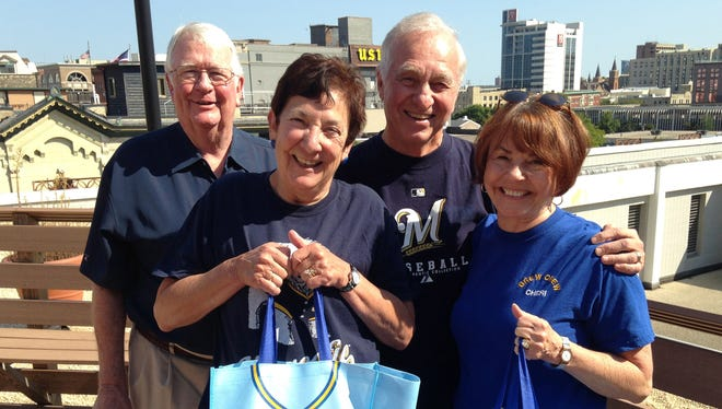 Longtime friends (from left) Tom and Pat Towers and George and Cheryl Domrose had planned to attend a game Sunday in Miami between the Milwaukee Brewers and Florida Marlins. Since 1989, they have attended one Brewers road game every year, and with this game would have visited every major league city in the National and American leagues. But Hurricane Irma forced the relocation of this weekend's series against the Marlins to Miller Park in Milwaukee, so the couples plan to visit Miami for a game next summer.