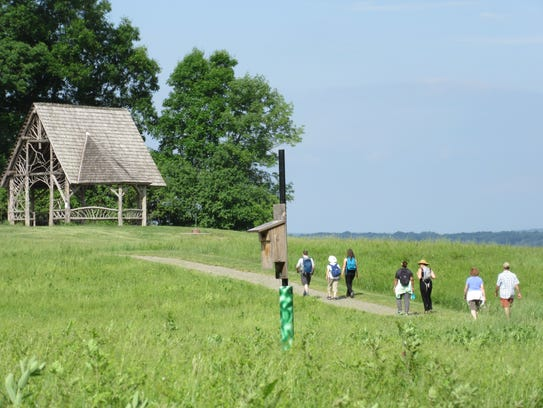 Hikers walk the path to the gazebo at Poet's Walk.