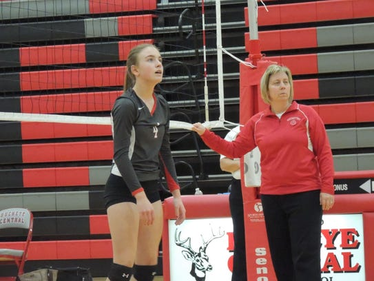 Buckette setter Addie Ackerman gets in a warm up before