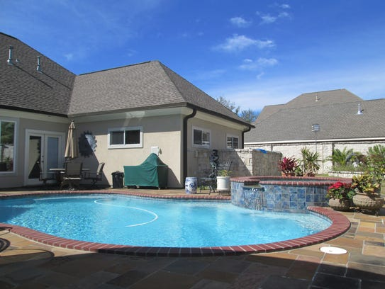 The beautiful pool includes a spa and space for entertaining.