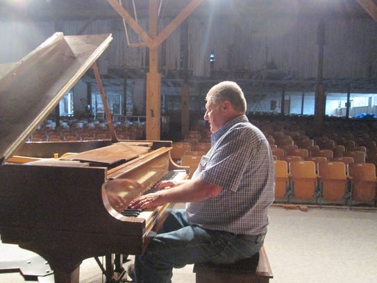 Harold Wildeson at his piano in the barn.