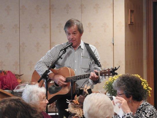 Folk and gospel singer John Schmid, of Holmes County,