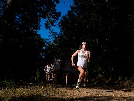 Senior Olivia Gardner raced cross country and track,