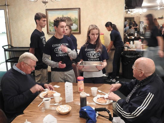 Key Club members serve Dick Kimberley, left, and Don