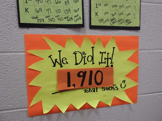 Students beat their goal in collecting socks for the