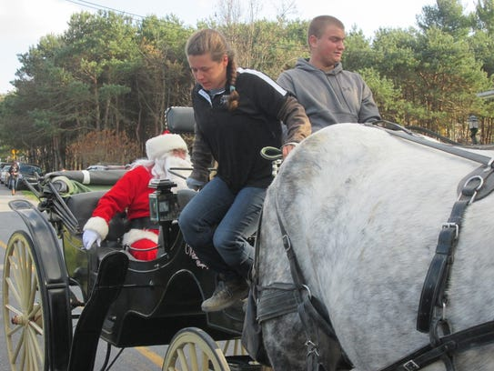 Kids never know how Santa will arrive at Mr. Ed's -