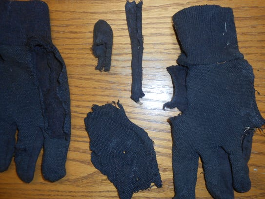 Photo shows the torn-apart gloves investigators found