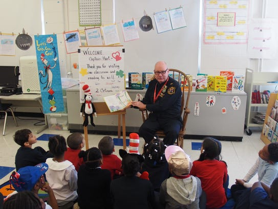 Linden Police Captain Dave Hart sat in the class reading