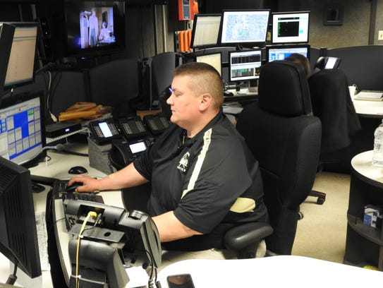 Sgt. Troy Bricker  fields calls to the Coshocton County