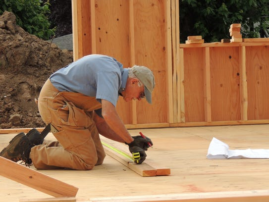 Habitat for Humanity volunteers pitch in with many