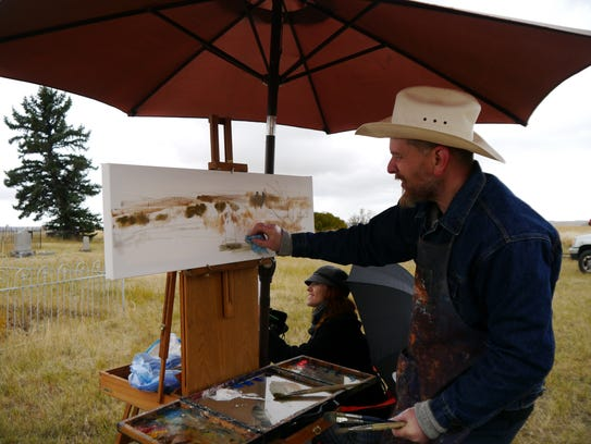 Dwight Cushman works on a landscape in oil inspired