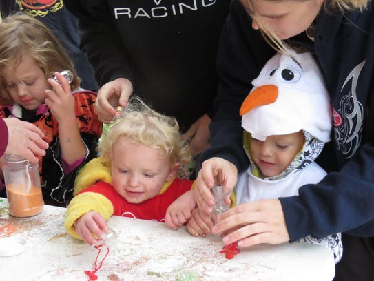 Trying their hand at art during Trunk or Treat.