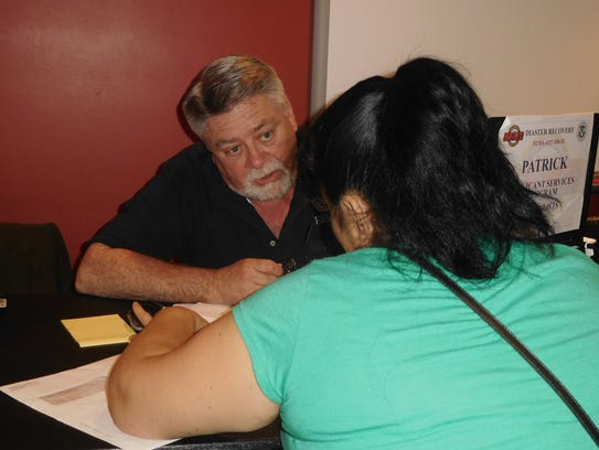 FEMA worker talks with applicant at Indian River State