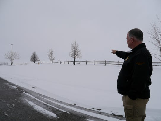 Undersheriff John Stevens points out where the 16-space