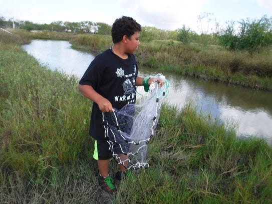 Xavier Balli, 10, learned how to throw a cast net during