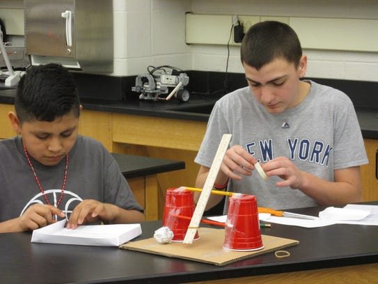 Jose Diaz-Onofre and Jacob DiGiovanni construct a catapult