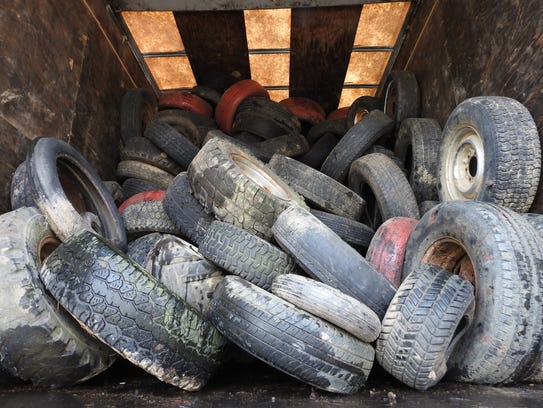 About 3,000 tires were loaded onto three trailers from
