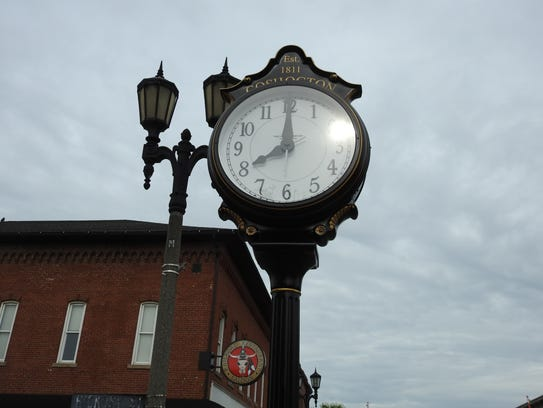 A recently erected memorial clock honors the late Cheryl