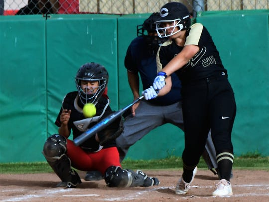 Clyde's Peyton Lee takes a cut at a pitch in front of catcher Chloe Castillo during the Lady Bulldogs' 10-0 win at Colorado City on Friday, April 13, 2018.