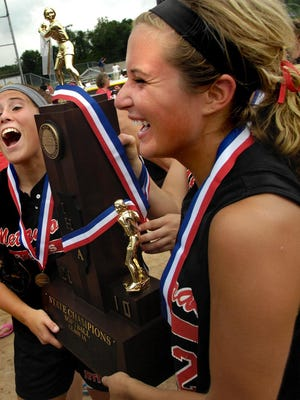 Metamora's Morgan Obery and Kristin Polanin hold the 2010 Class 3A softball state championship trophy after their victory at EastSide Centre in East Peoria.