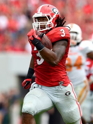 Georgia Bulldogs running back Todd Gurley (3) runs for a touchdown against the Tennessee Volunteers during the second half at Sanford Stadium. Georgia defeated Tennessee 35-32.