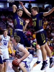 Jack Trudo of Van Meter drives to the basket during