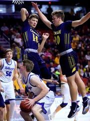 Jack Trudo of Van Meter drives to the basket during