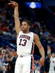 Auburn's Desean Murray celebrates after making a 3-point
