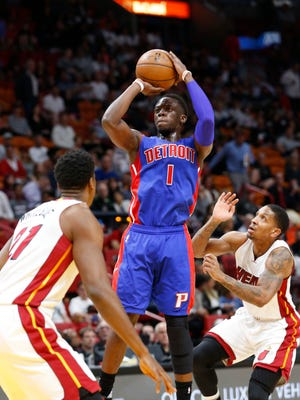 Pistons guard Reggie Jackson shoots against Miami Heat center Hassan Whiteside (21) and guard Rodney McGruder, right, during the first half Saturday, Jan. 28, 2017, in Miami.