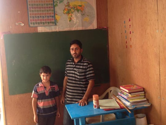 Ahmed, a teacher at a school built by residents of