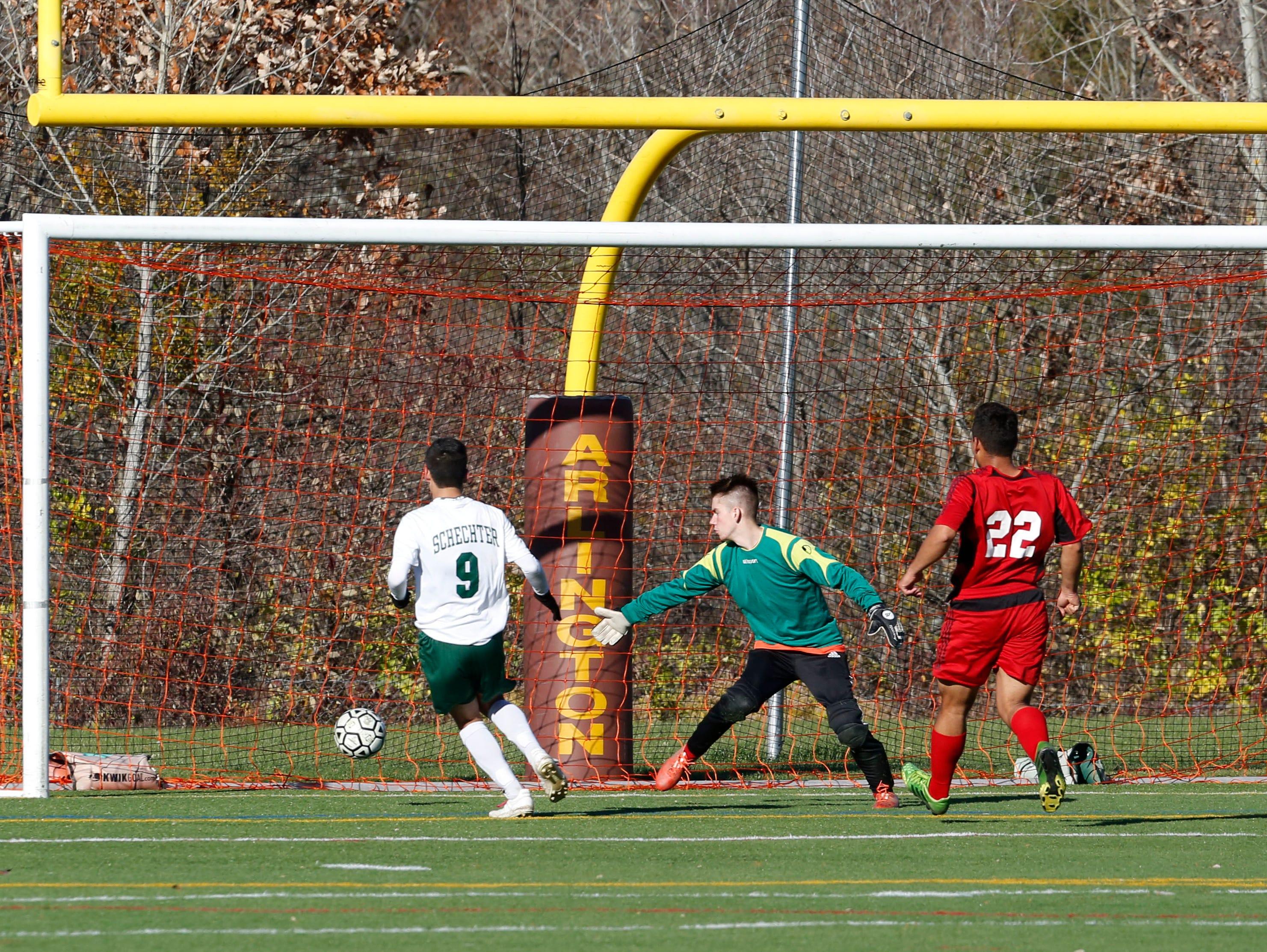 Solomon Schechter's Miles Ogihara scores the winning goal against Hamilton's Conor Brosnan in the Class C boys soccer final Oct. 30, 2015 at Arlington High School in Lagrangeville. Solomon Schechter won, 2-1, in overtime.
