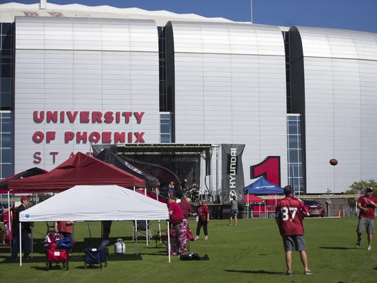 Tailgaters set up before the Arizona Cardinals play