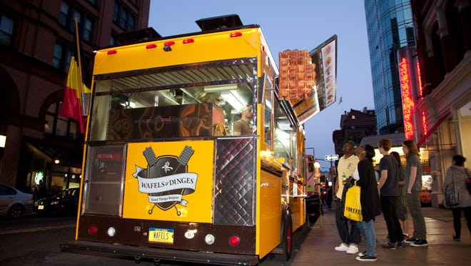 Food trucks across the USA are increasingly serving up unique desserts like Belgian waffles from the Wafels and Dingels truck in New York City.