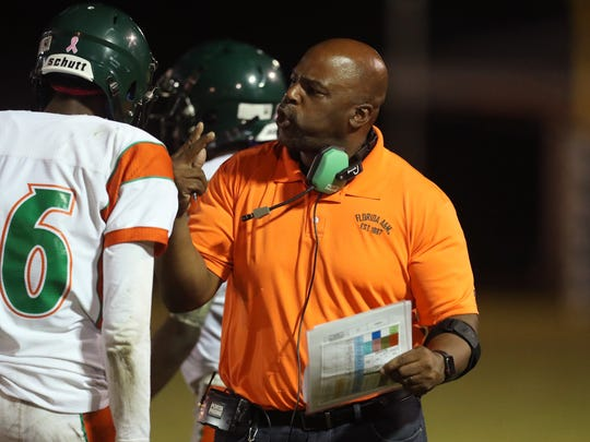 FAMU DRS Head Coach Cedric Jonestalks to his team during a timeout against Maclay during their game at Maclay school on Friday, Oct. 20, 2017.