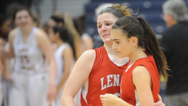 Lenape's Amanda McGrogan, left, hugs her teammate Gianna Risica after losing to St. John Vianney 57-36 in a  Tournament of Champions semifinal game at Pine Belt Arena in Toms River.