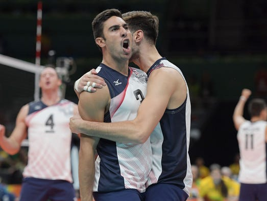 The United States volleyball team celebrates during
