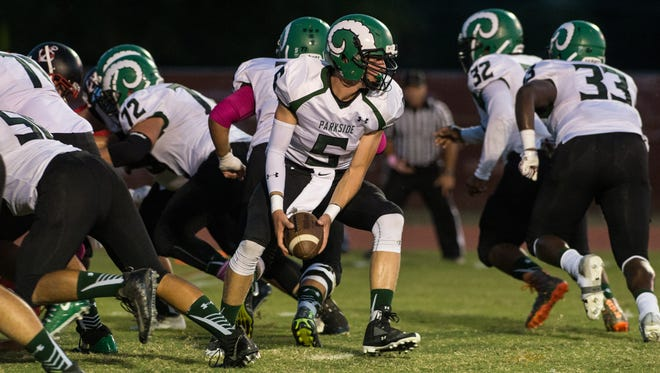 Parkside's Andrew Smith (5) prepares for a running play during a game against James M. Bennett on Friday, Oct. 6, 2017.