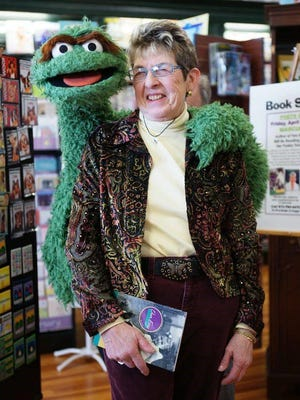 Marcia Ivans makes a friend at a book reading.