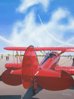 """""""Showtime,"""" a 29-by-35-inch oil painting on canvass by Robert Aikins is a previous American Society of Aviation Arts competition winner. It shows a WACO biplane viewing aerobatics at the 2007 Columbus, Ohio air show."""