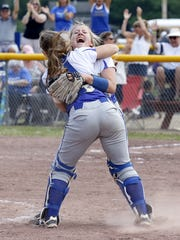 Maine-Endwell pitcher Emily Hess, background, celebrates with catcher Mikayla Gabarino after the Spartans' 1-0 win over Williamsville East on Saturday in the Class A state final at Moreau Recreational Park in South Glens Falls.