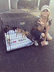 Miranda Lambert poses with dogs pulled out of Houston-area shelters. Her MuttNation Foundation removed adoptable dogs from Houston-area shelters to make room for pets displaced by Hurricane Harvey.