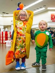 Everlee and Leyton Hansen, 5 and 2, satisfied their hunger to play on Halloween dressed as a taco and an avocado.